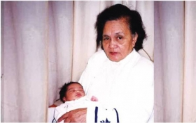 3-day old Fasika in the loving arms of late grandma, Felipa Nisperos.