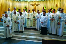 Fr. Renato Paras at the centre with other priests
